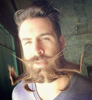 As beard as it gets: Meet Isaiah Webb, who styles his 17-inch-long beard into unique designs